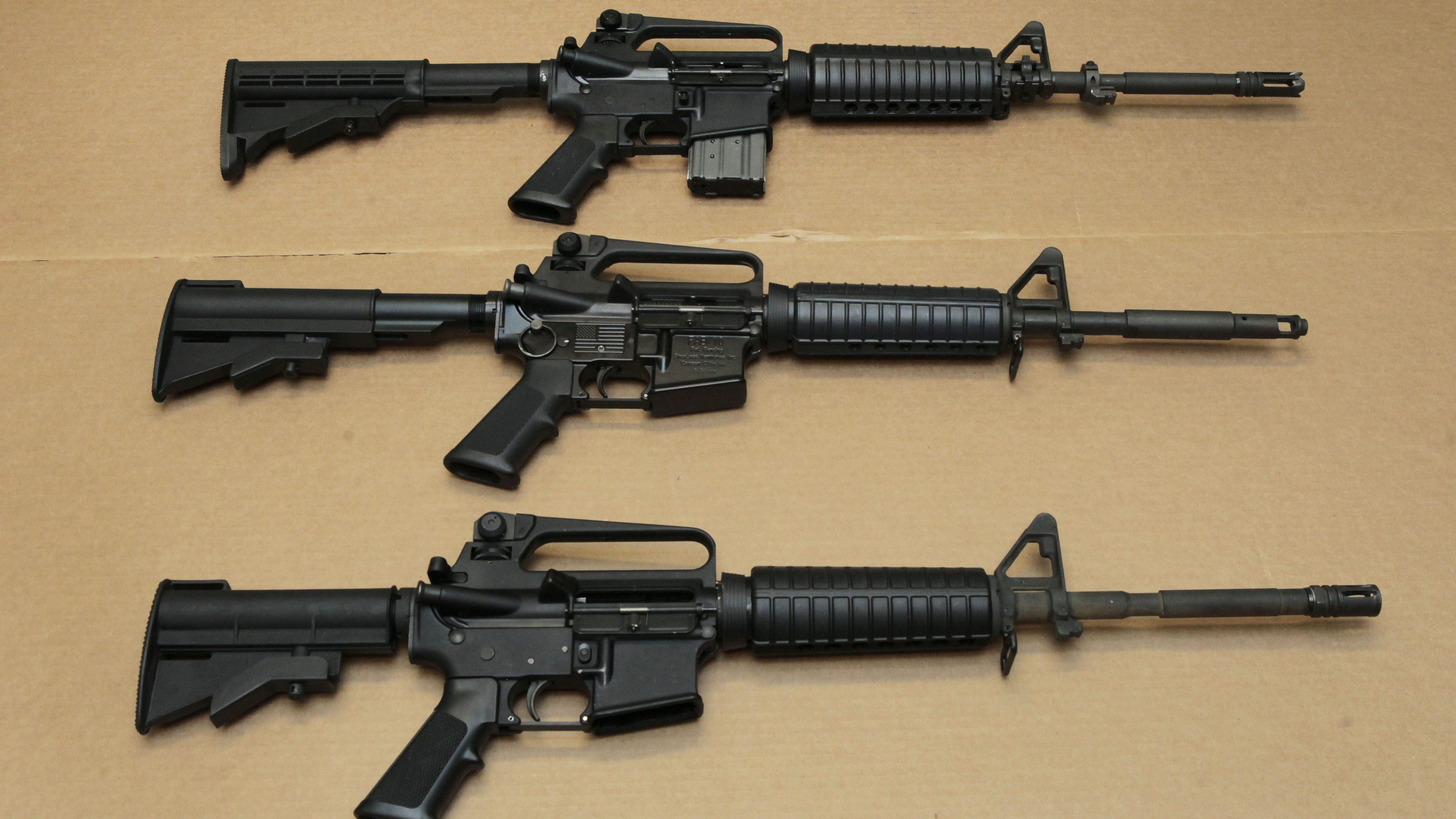Three variations of the AR-15 assault rifle