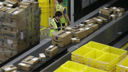 People working in an Amazon warehouse.