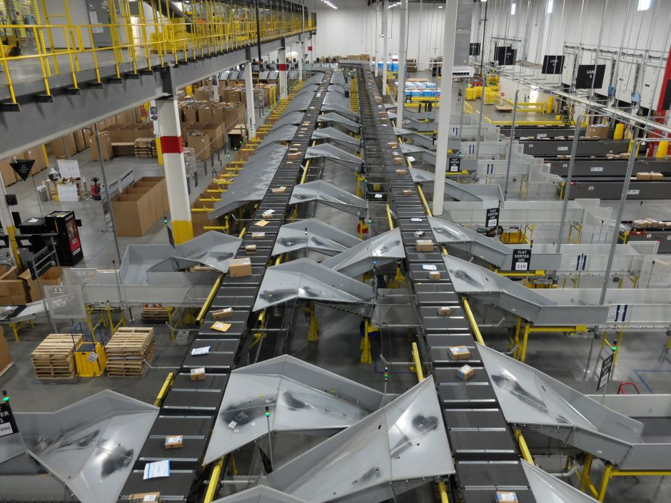 Amazon packages on conveyor belt