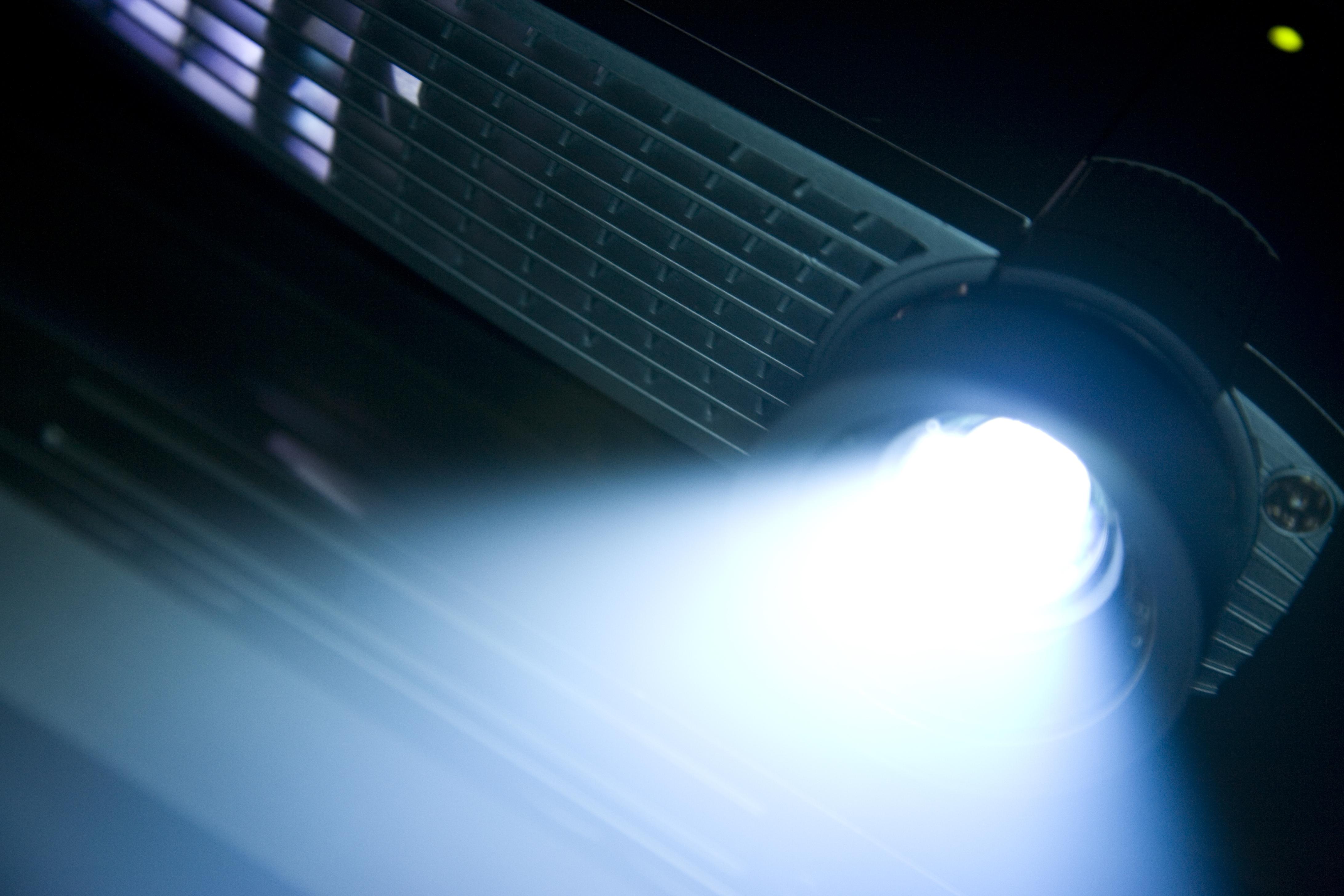 A digital projector's light shines