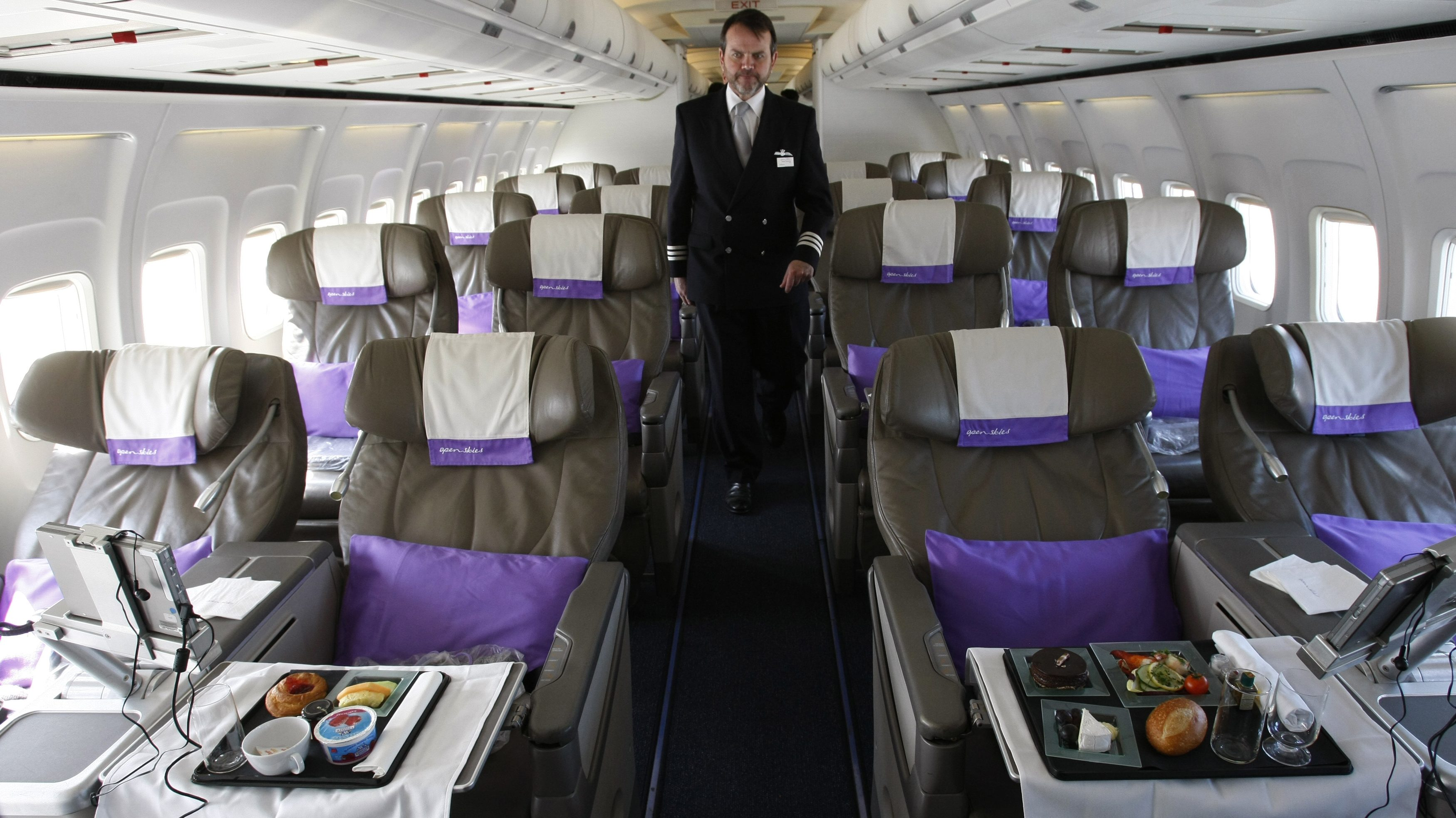 OpenSkies Airline Senior Flight Officer Andy Pomeroy walks down the aisle of one of its Boeing 757-200 jets that features 84 business class seats only cabins in Dulles Virginia
