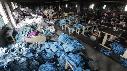 Piles of clothes in a sweatshop in Bangladesh