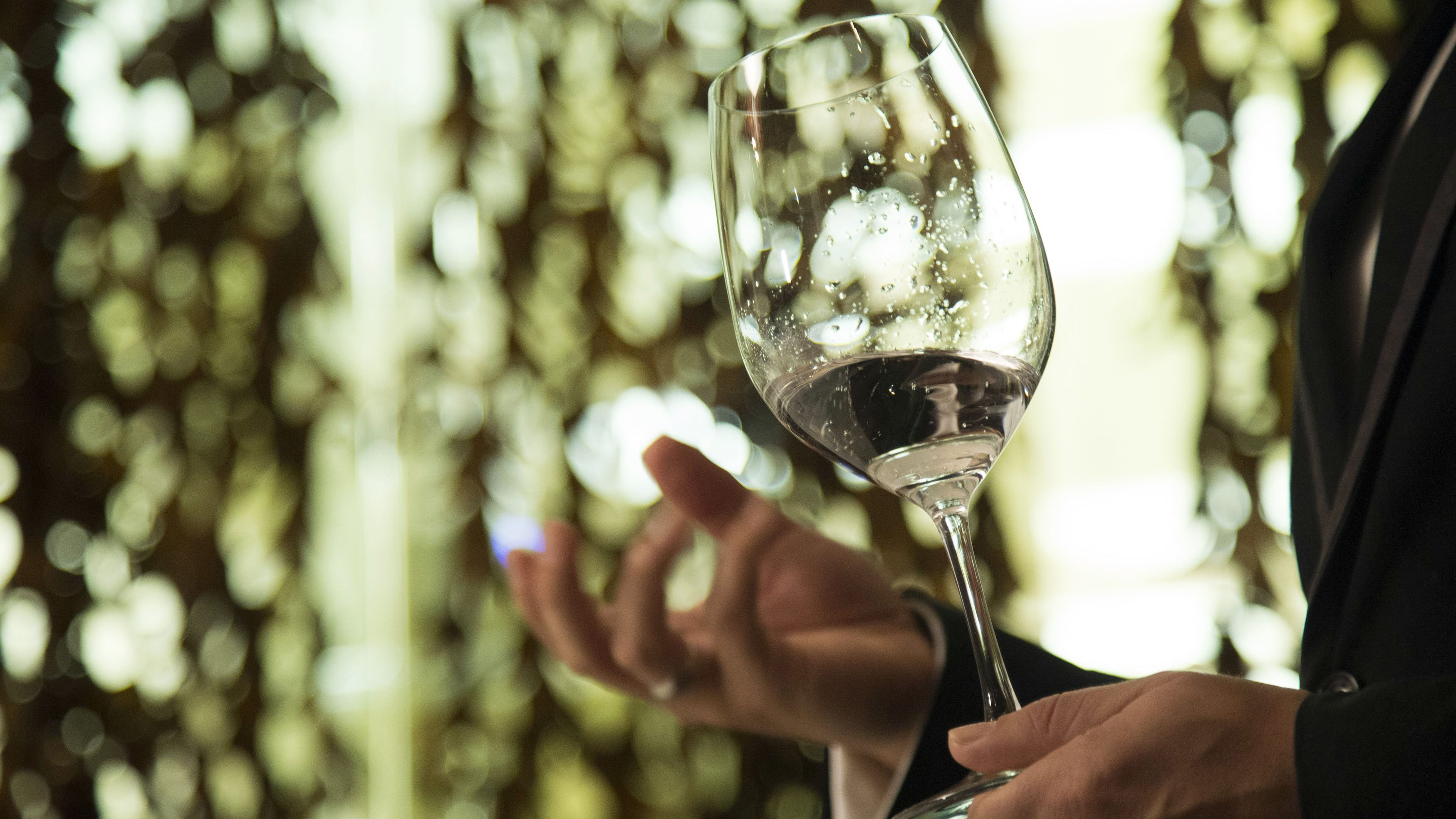 German water sommelier Riese holds a glass of Roi water during a water tasting class at Patina restaurant in Los Angeles