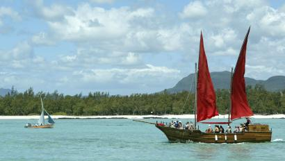 Two boats off the coast of Mauritius, including the replica of a pirate galleon.