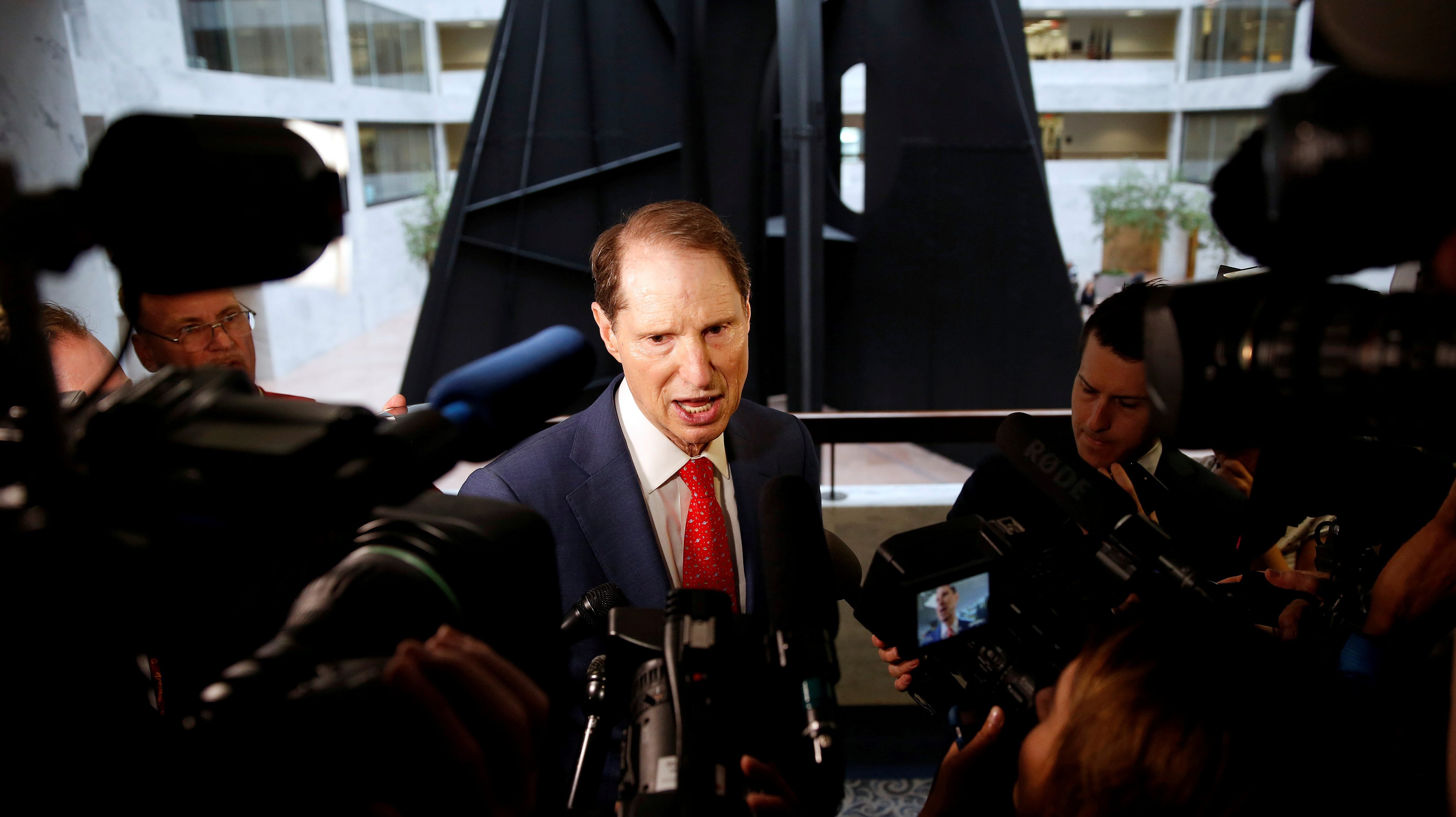 "Senator Ron Wyden arrives for a Senate Intelligence Committee hearing evaluating the Intelligence Community Assessment on ""Russian Activities and Intentions in Recent US Elections"" in 2018."