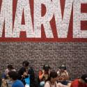 Visitors sit under a Marvel sign at the China International Cartoon and Game (CCG) Expo in Shanghai,