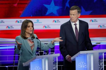 Former Colorado Governor John Hickenlooper watches Marianne Williamson speak at the first round of democratic debates for the 2020 presidential election.