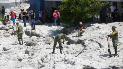 Soldiers clear away ice after a heavy storm of rain and hail in Guadalajara
