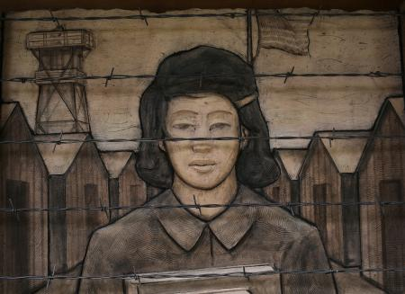 A frieze depicts an imprisoned schoolgirl at the Japanese American Exclusion Memorial on Bainbridge Island