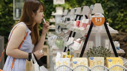 A customer tries a lipstick at a shop of Innisfree in central Seoul