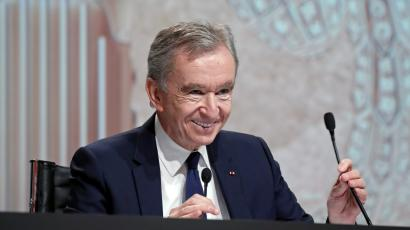 Bernard Arnault, CEO of LVMH, smiles cheerfully at the company's annual shareholder meeting