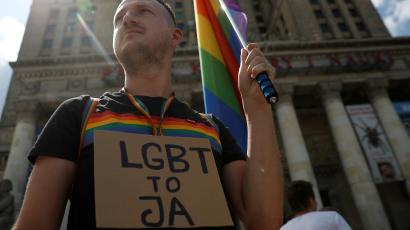 Pawel Szamburski, 29, participates in the protest against violence that took place against the LGBT community during the first pride march in Bialystok earlier this month, in Warsaw, July 27, 2019. The banner reads ''LGBT is me'