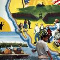 A Honduran migrant stands in front of a colorful mural in the northwest Guatemalan border city of Tecun Uman.