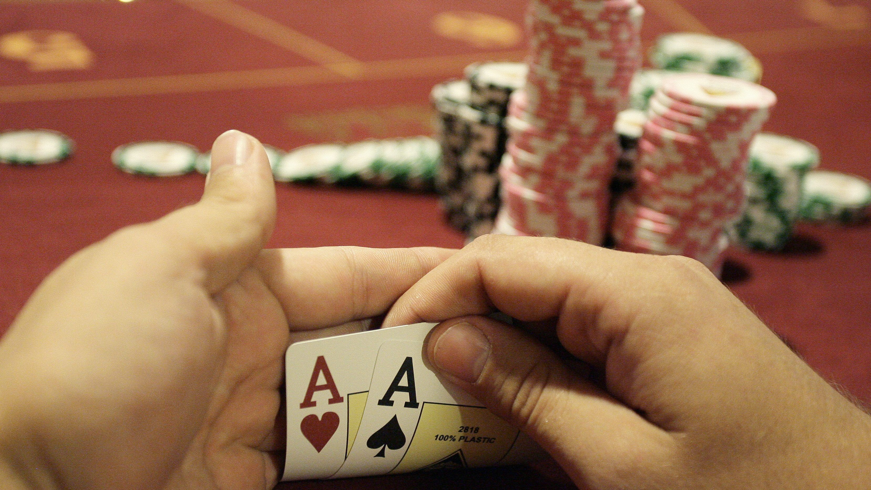 A player checks his cards during the finals of the Russian Masters Poker Cup .