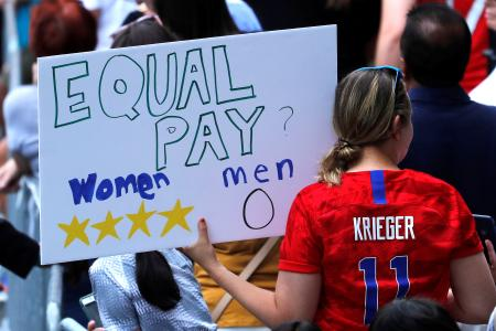 Women's World Cup Champions Parade - New York, United States - July 10, 2019 A fan displays a sign during the parade.