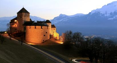 Cars drive past Vaduz Castle in Liechtenstein's capital Vaduz in this March 14, 2012 file photo.