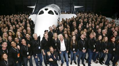 Richard Branson poses after unveiling the new SpaceShipTwo, a six-passenger two-pilot vehicle meant to ferry people into space that replaces a rocket destroyed during a test flight in October 2014, in Mojave, California, United States,