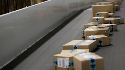 Picture showing Amazon packages on a conveyor belt.