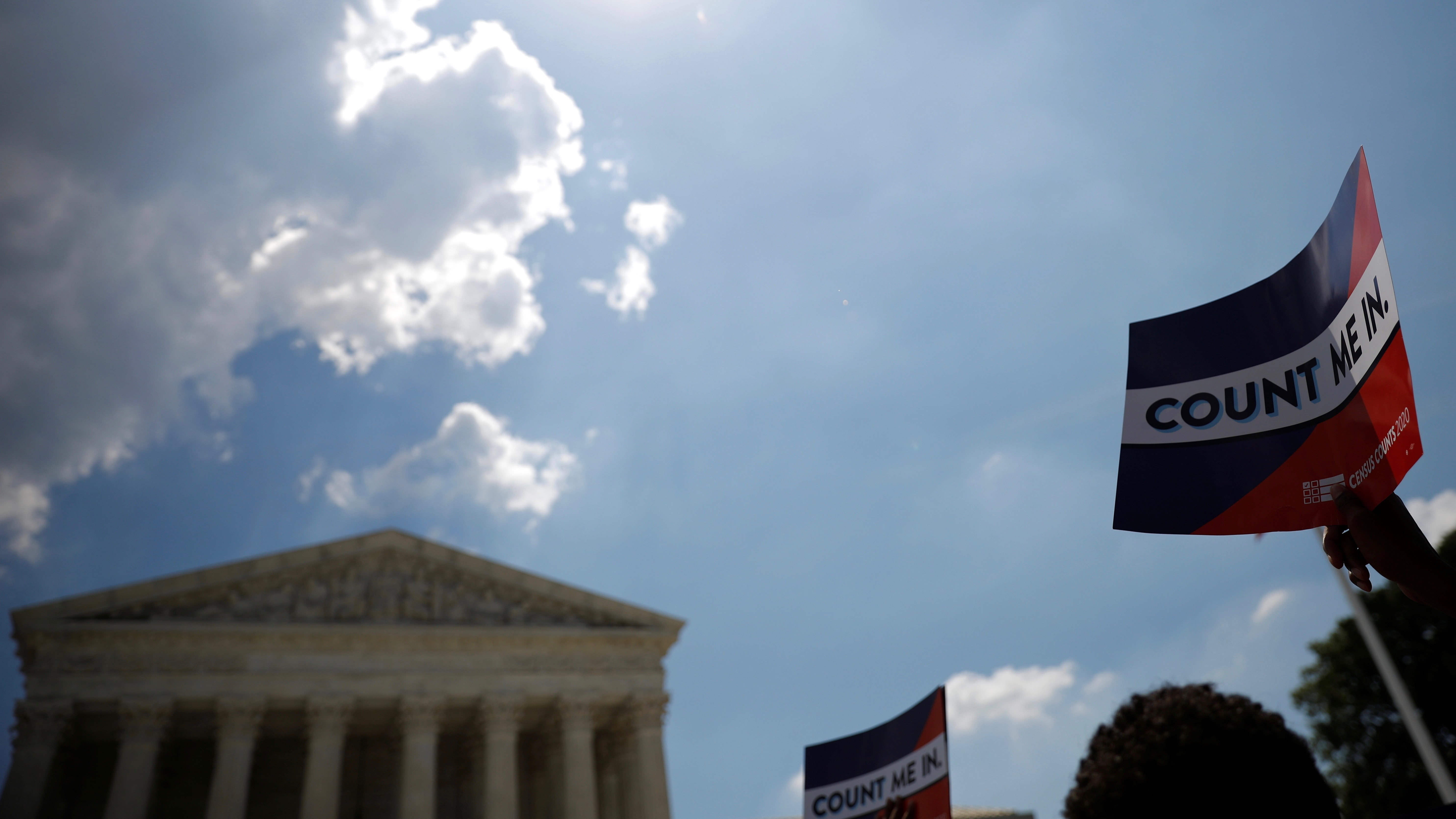 A protester holds sign outside the U.S. Supreme Court in Washington