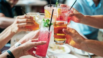 Adults toasting alcoholic drinks