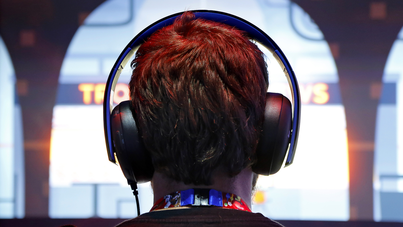 A gamer wears headphones while playing a game at the 2014 Electronic Entertainment Expo, known as E3, in Los Angeles, California June 10, 2014.