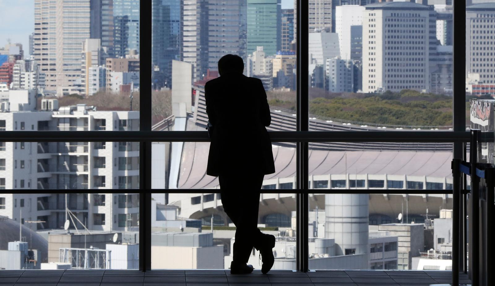 A silhouette of a man in an office