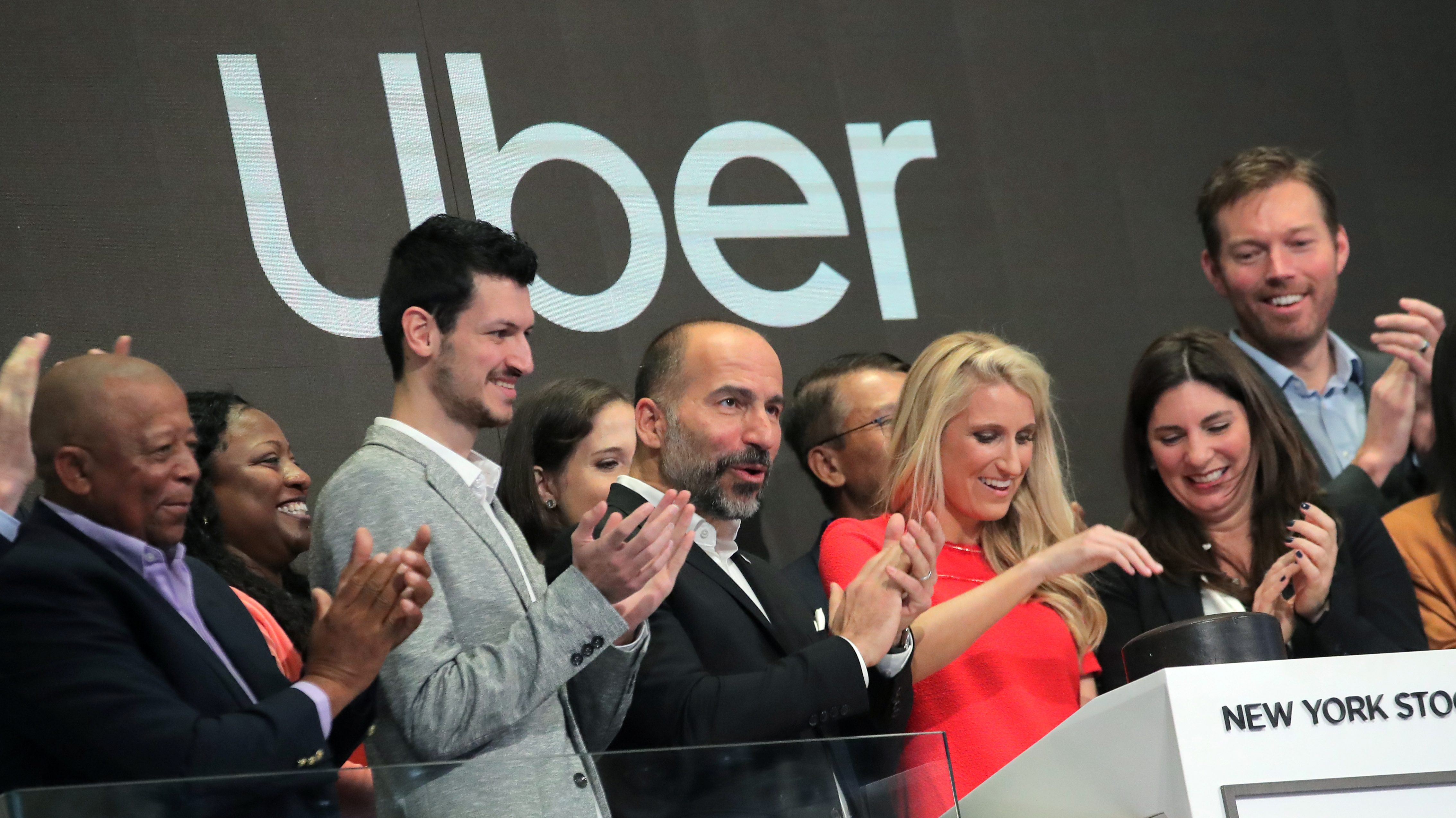 Uber executives cheer at the company's May 10 IPO.