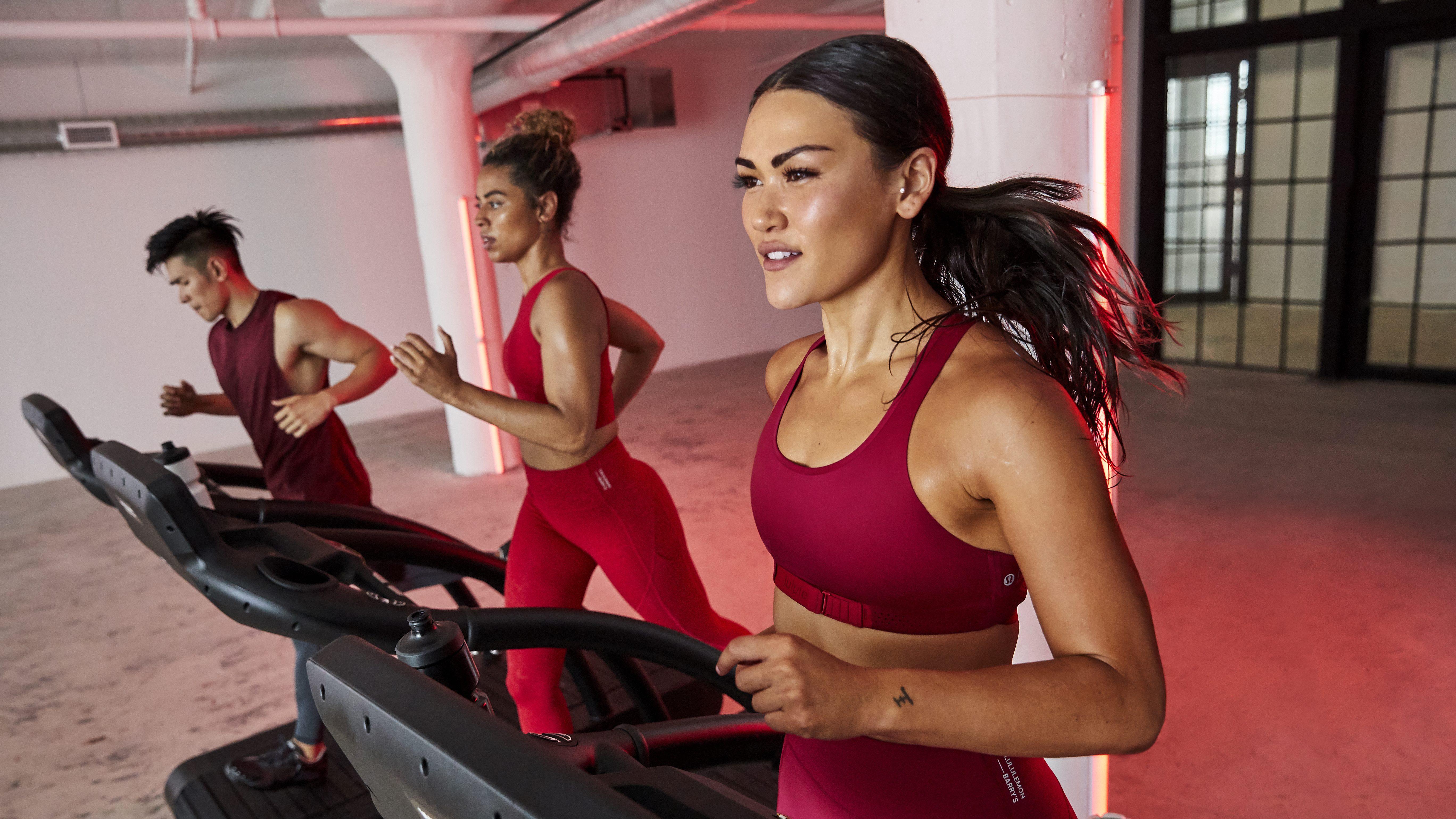 A woman runs on a treadmill