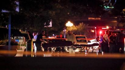 Stretchers and ambulances are pictured in the night carrying away bodies after the Dayton, Ohio mass shooting