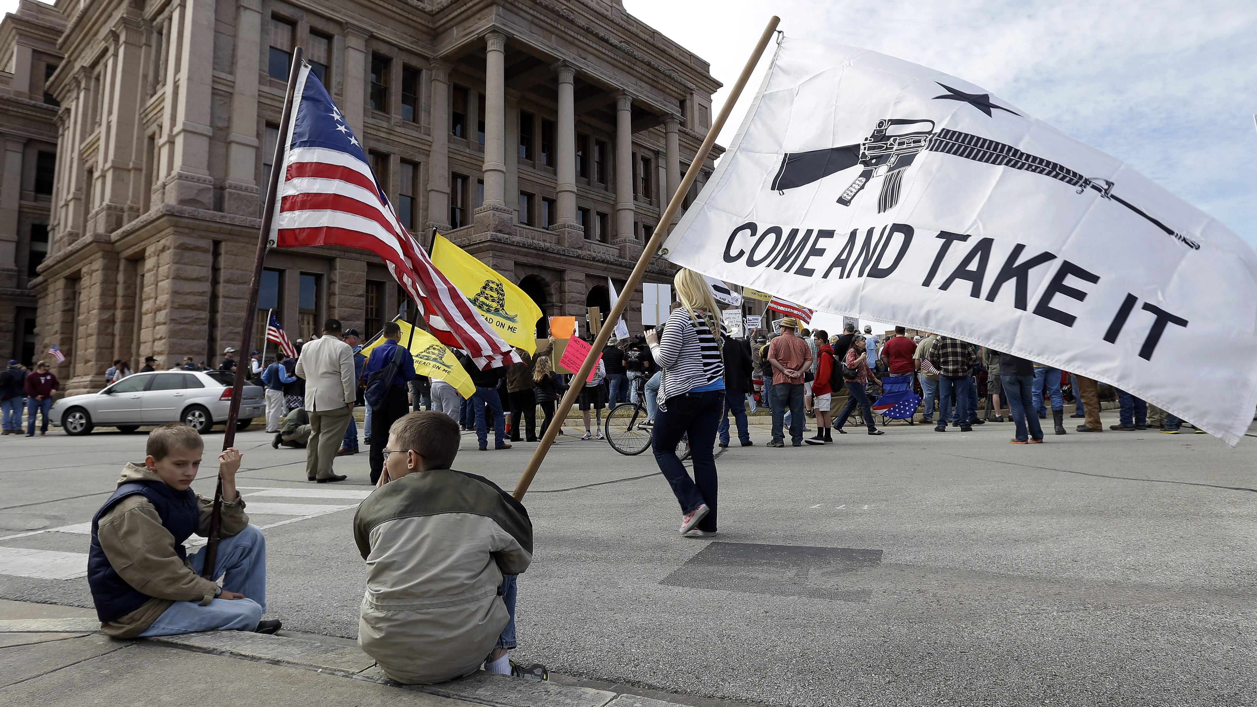 Children pictured with a pro-gun flag in Texas
