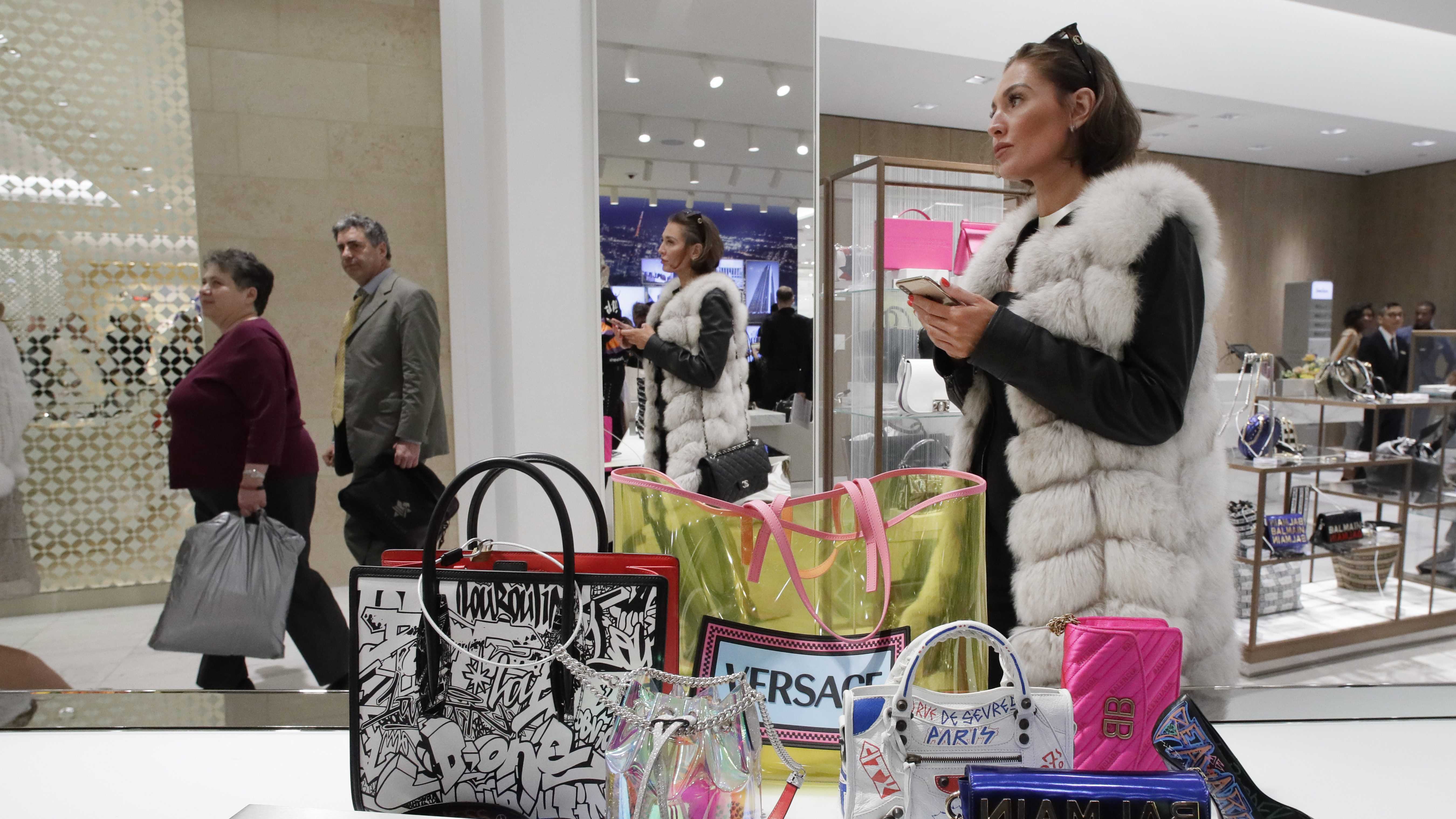 A woman in a furry vest shops at Neiman Marcus in New York