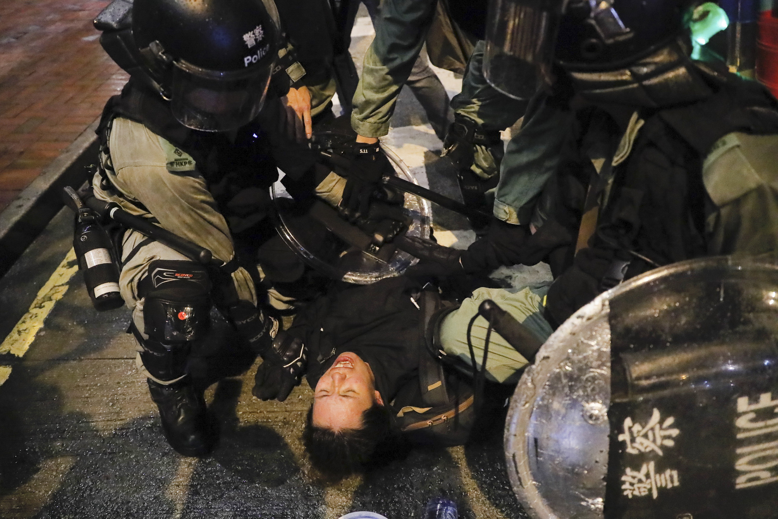Riot police arrest a protester during a pro-democracy protest in causeway bay, Hong Kong, Saturday, Aug. 31, 2019.