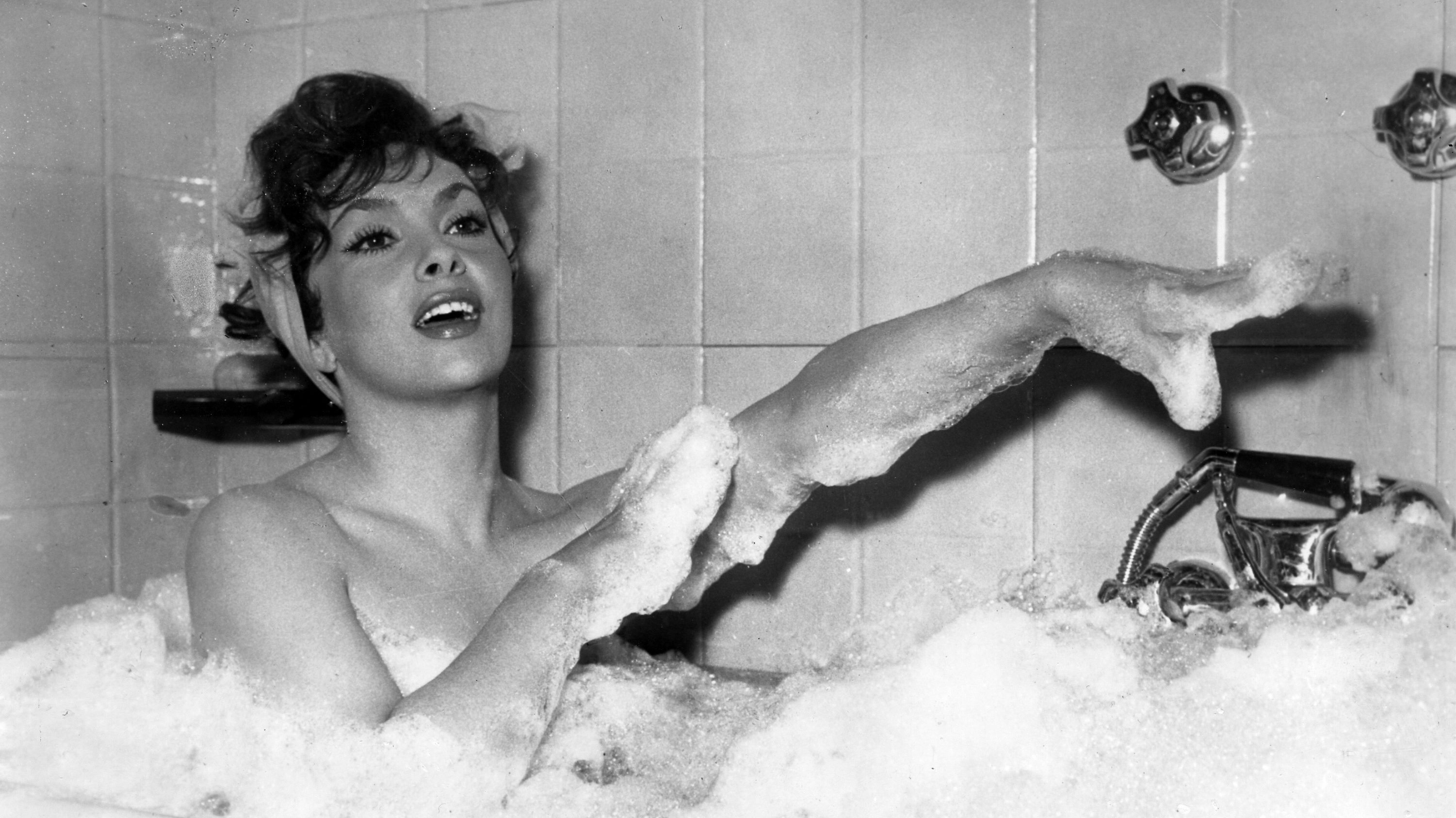 "Italian actress Gina Lollobrigida takes a bubble bath in a scene of her new film called ""Anna from Brooklyn"""