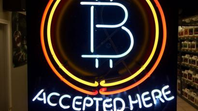 Neon sign declaring bitcoin accepted here