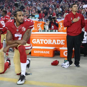 San Francisco 49ers Eric Reid (35) and Colin Kaepernick (7) take a knee during the National Anthem prior to their season opener against the Los Angeles Rams during an NFL football game Monday, Sept. 12, 2016, in Santa Clara, CA. The Niners won 28-0. (Daniel Gluskoter/AP Images for Panini)