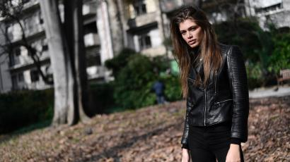 Valentina Sampaio delivers her best sultry stare in a black leather jacket