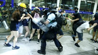 Police clash with anti-government protesters at the airport in Hong Kong