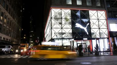 The new Puma flagship lit up at night on 5th Avenue in New York