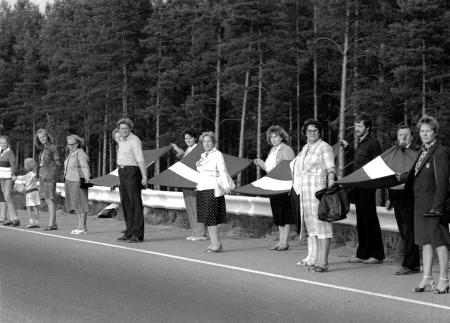 People hold hands and Latvian flags as they participate in a human chain at Baltic Way near Riga August 23, 1989. Runners left Lithuania and Estonia on August 22, 2009, for neighbouring Latvia to start events marking the 20th anniversary of a 600 km (375 mile) human chain that showed the Balts' wish to regain their independence from the Soviet Union. More than two million people in the Baltic countries of Estonia, Latvia and Lithuania joined hands in one of the biggest mass protests seen against the former Soviet Union and demanded the restoration of independence. Picture taken August 23, 1989.