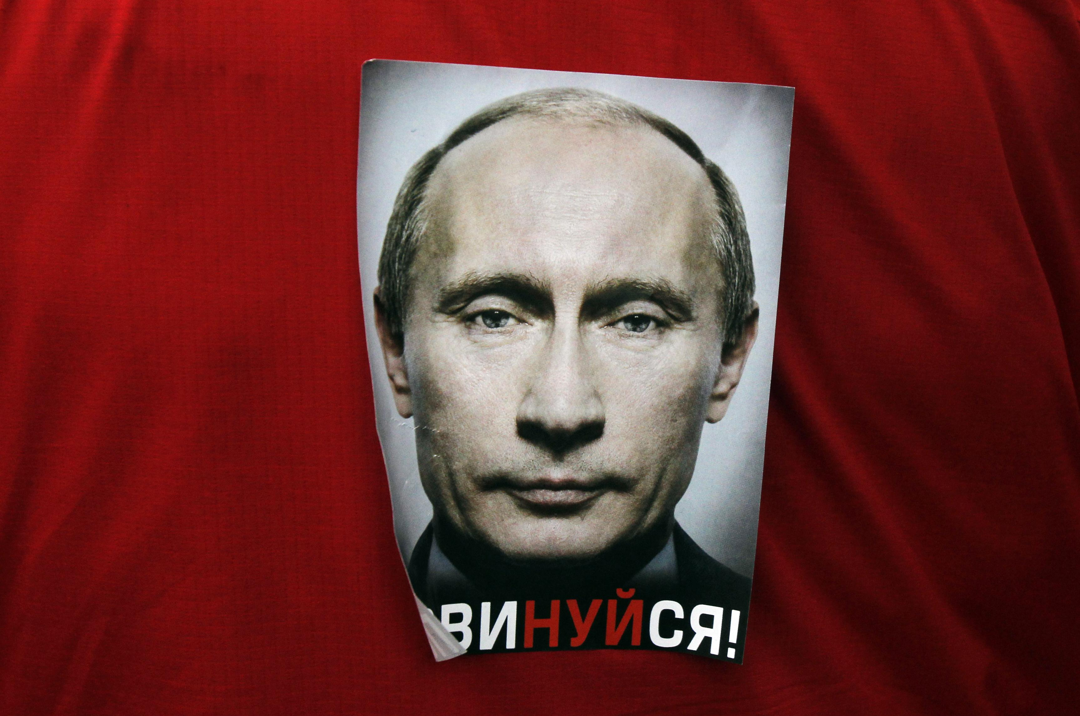 A poster of Putin