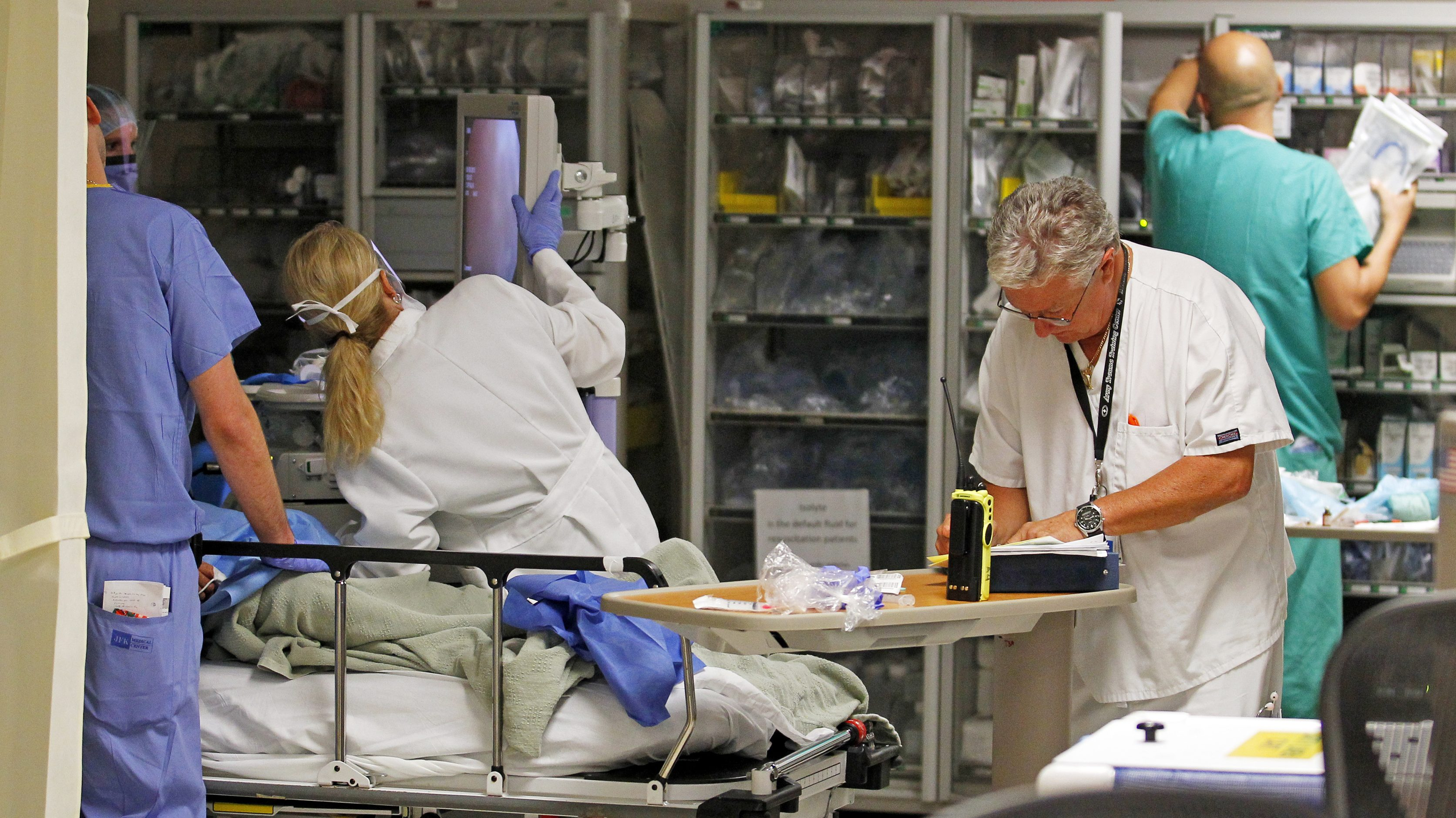 Doctors and nurses work on a patient in the Ryder Trauma Center at Jackson Memorial Hospital in Miami