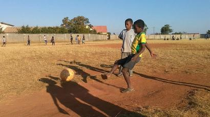 Malagasy children play soccer on a pitch in Ankazobe town of Analamanga Region