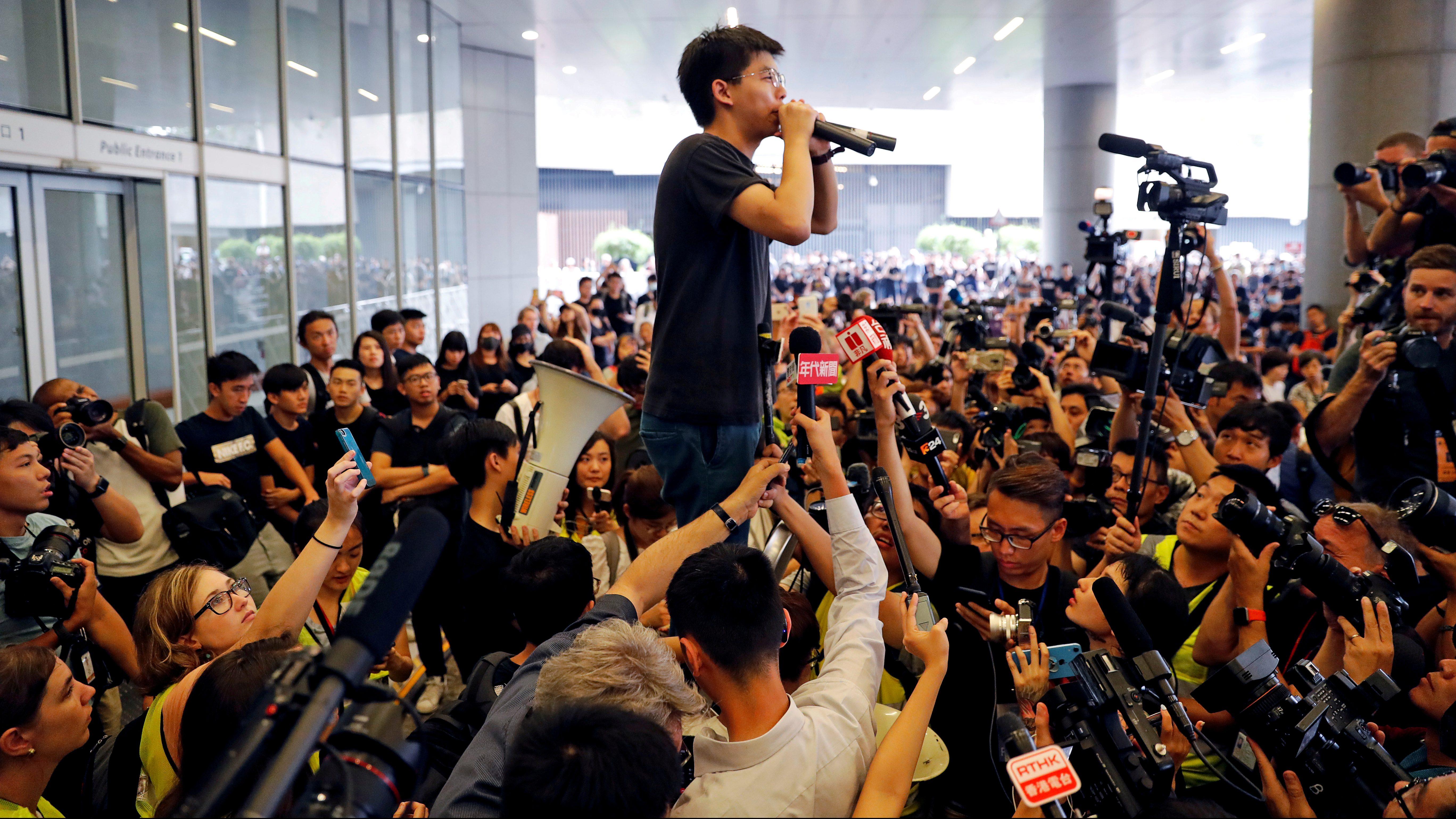 Pro-democracy activist Joshua Wong addresses the crowds outside the Legislative Council on June 17 2019