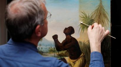 David Crombie, Senior Paintings Conservator at the National Museums, Liverpool carries out restoration work on the painting 'Am Not I A Man And A Brother', one of only 2 known paintings of its type in existence in Liverpool, Britain, July 30, 2019.