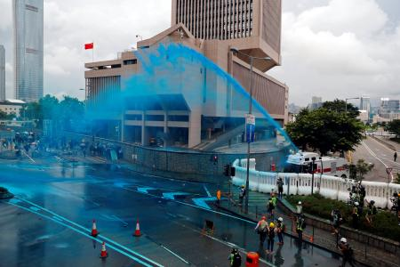 Riot police use water cannon to disperse anti-extradition bill demonstrators during a protest in Hong Kong, China, August 31, 2019.