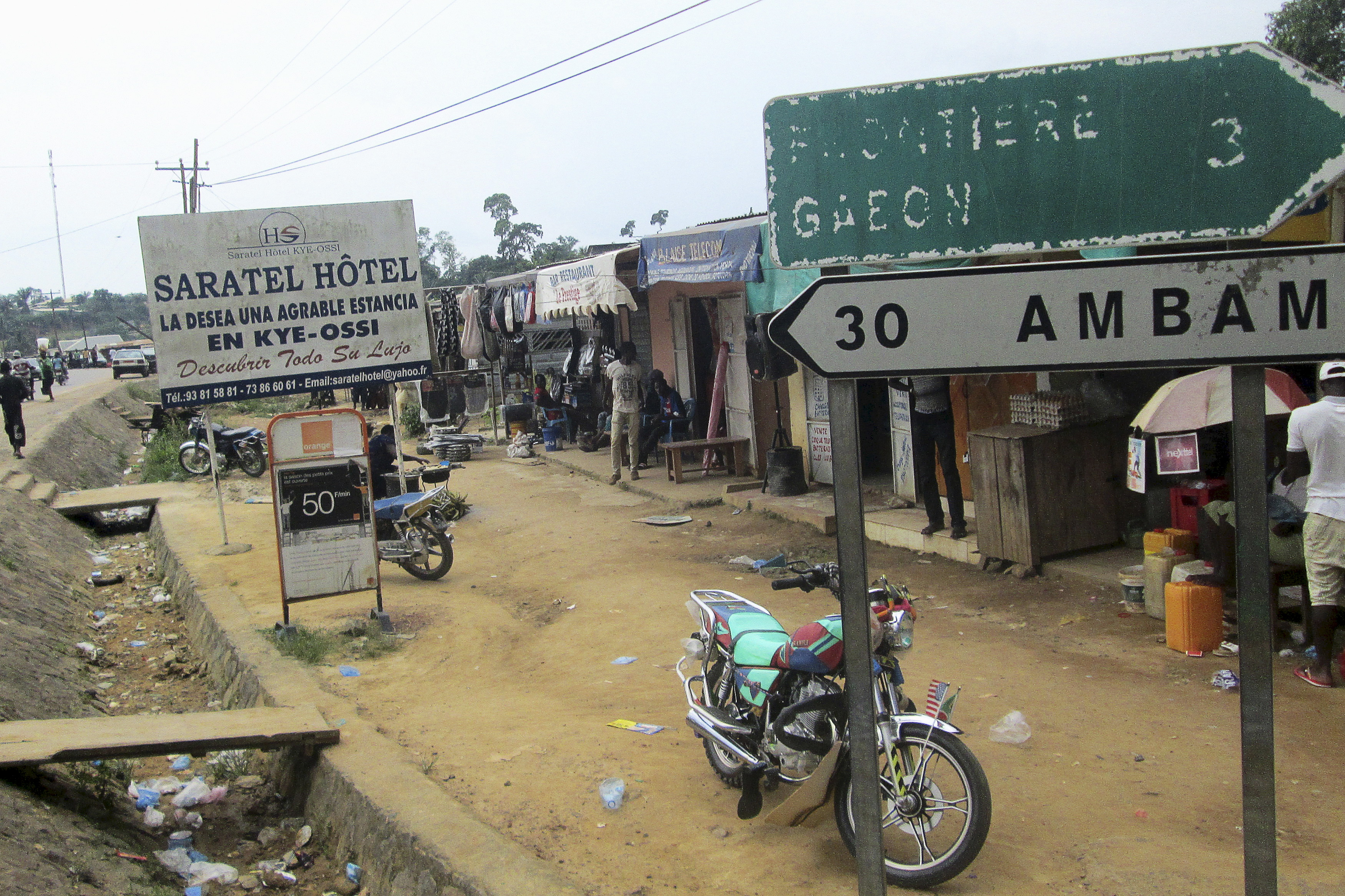 Signs are seen on the border with Equatorial Guinea and Gabon in Kye-Ossi