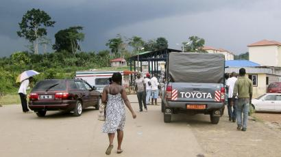 People wait to cross the border into Equatorial Guinea by car and by foot in Kye-Ossi