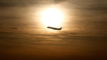 A plane is seen during sunrise at the international airport in Munich