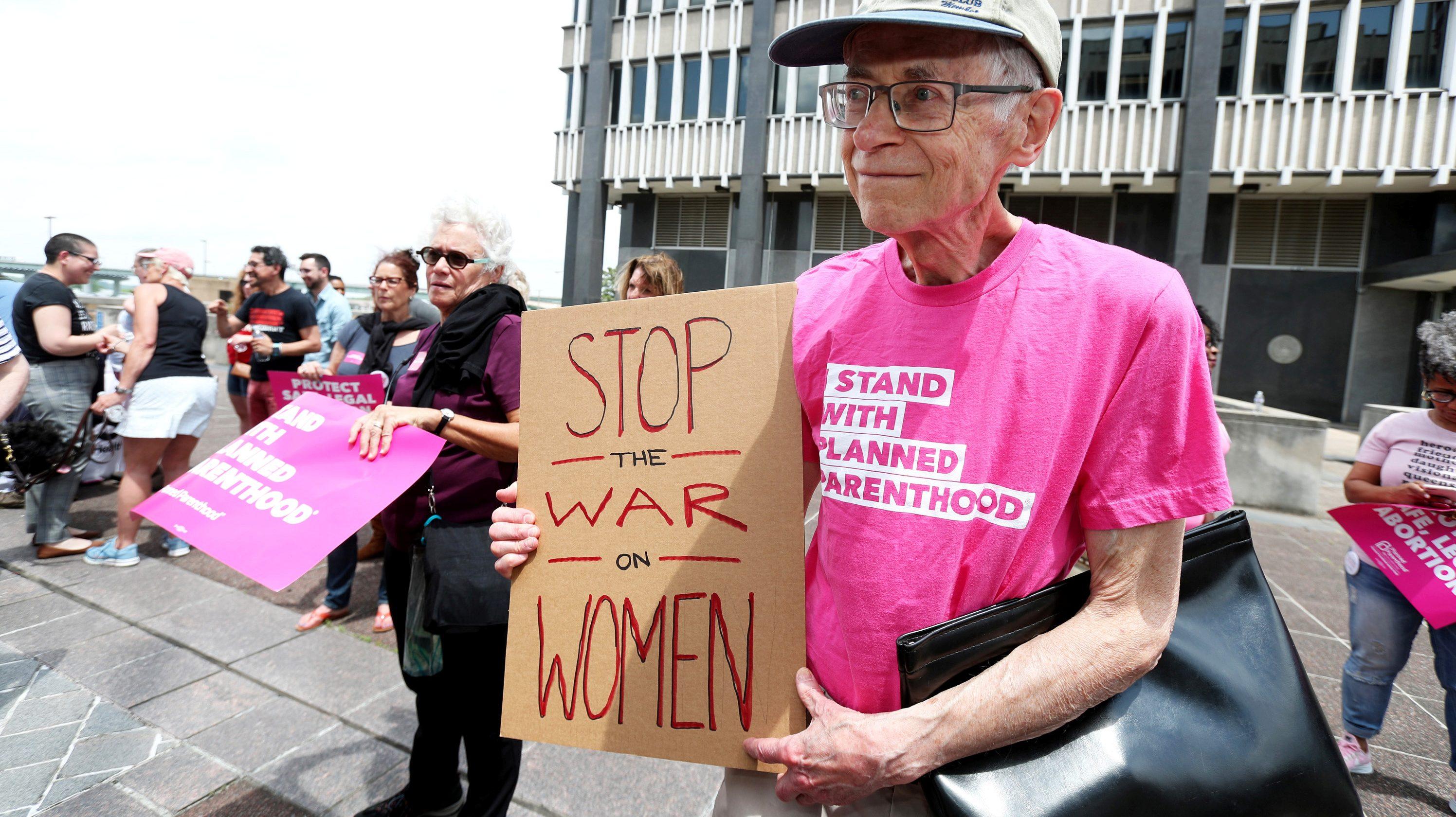 A pro-choice activist holding a sign