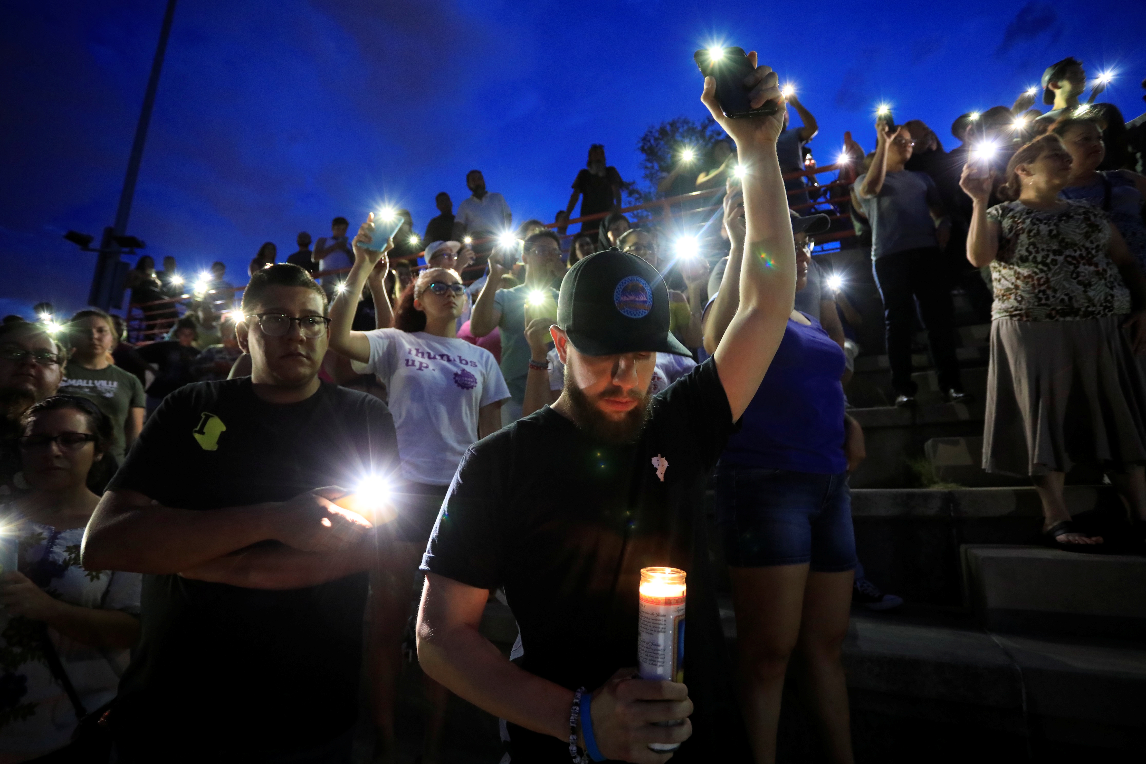 Mourners take part in a vigil at El Paso High School after a mass shooting at a Walmart store in El Paso